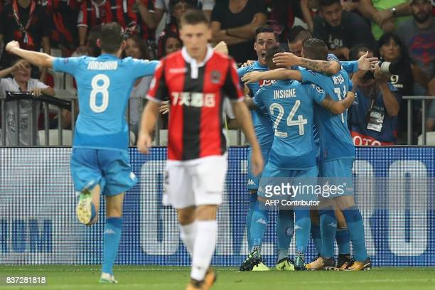 Napoli's Spanish striker Jose Maria Callejon celebrates with teammates after scoring a goal during the UEFA Champions League playoff football match...