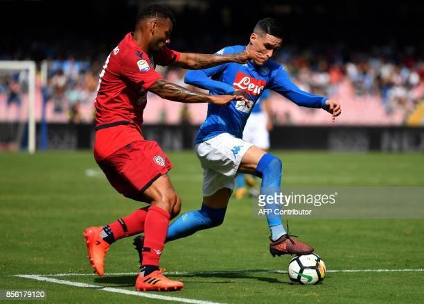 Napoli's Spanish striker Jose Maria Callejon fights for the ball with Cagliari's midfielder from Brazil Galvao Joao Pedro during the Italian Serie A...