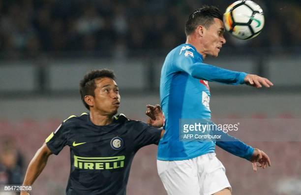 Napoli's Spanish striker Jose Maria Callejon heads the ball next to Inter Milan's Japanese defender Yuto Nagatomo during the Italian Serie A football...