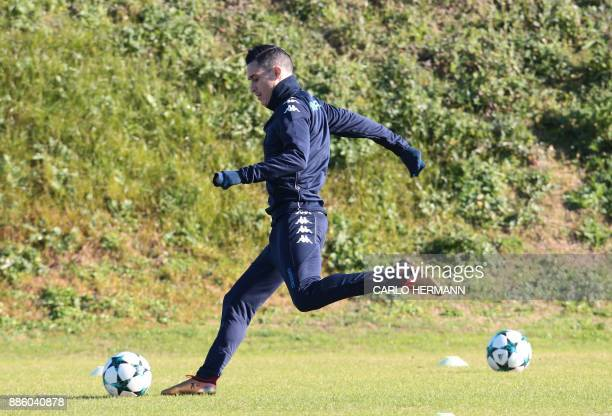 Napoli's Spanish striker Jose Maria Callejon kicks the ball during a training session on the eve of the UEFA Champions League Group F football match...