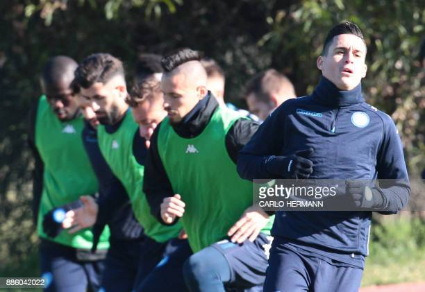 Napoli's Spanish striker Jose Maria Callejon takes part in a training session on the eve of the UEFA Champions League Group F football match...