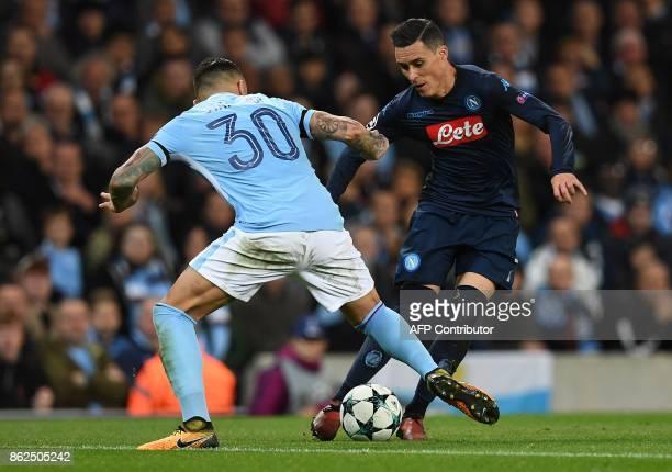 Napoli's Spanish striker Jose Maria Callejon vies with Manchester City's Argentinian defender Nicolas Otamendi during the UEFA Champions League Group...