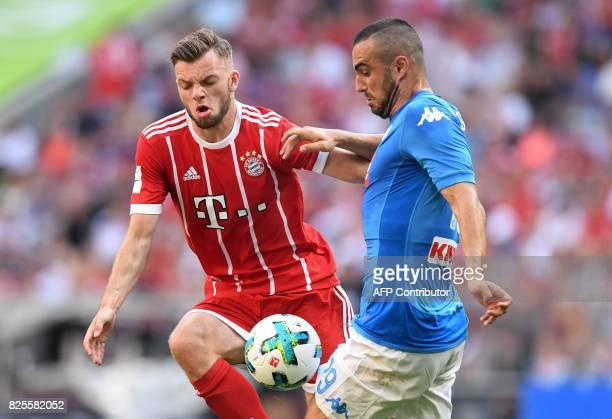 Napoli's striker Leonardo Pavoletti and Bayern Munich's midfielder Manuel Wintzheimer vie for the ball during the third place Audi Cup soccer match...