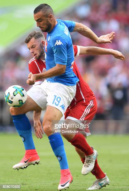 Napoli's striker Leonardo Pavoletti and Bayern Munich's midfielder Manuel Wintzheimer vie for the ball during the third place Audi Cup football match...