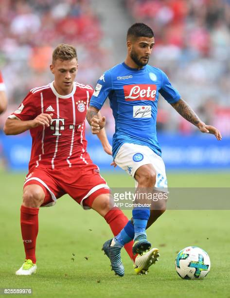 Napoli's striker Lorenzo Insigne and Bayern Munich's midfielder Joshua Kimmich vie for the ball during the third place Audi Cup soccer match between...