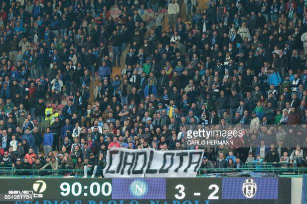 Napoli's supporters hold a banner reading 'bye bye mud' at the end of the Tim Cup semifinal second leg football match SSC Napoli vs Juventus FC on...