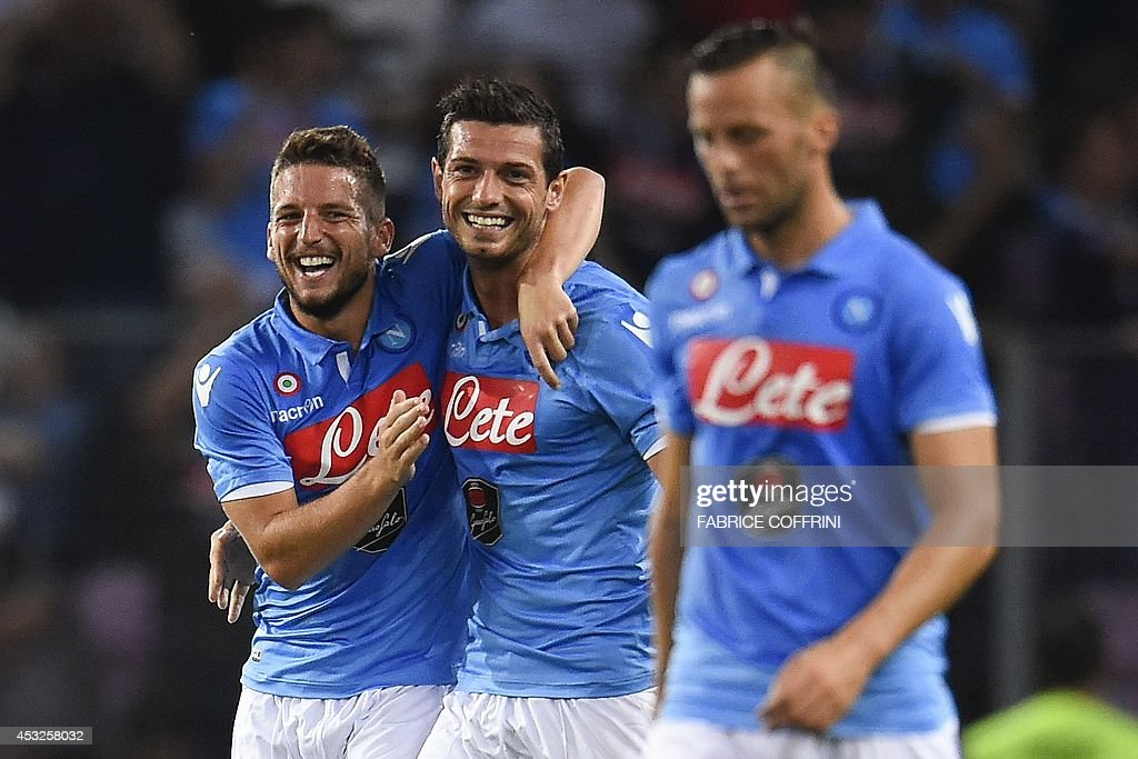 Napoli's Swiss midfielder Blerim Dzemaili celebrates with Belgian forward Dries Mertens (L) after scoring a goal during a friendly football match between Barcelona and Napoli in Geneva on August 6, 2014.