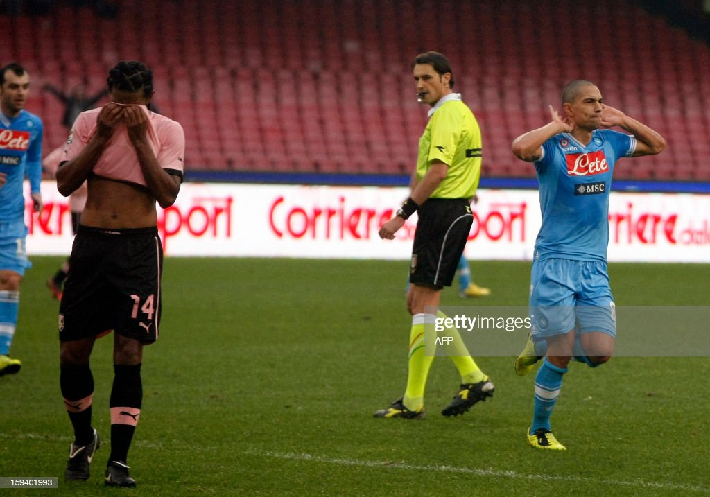 Napoli's Swiss midfielder Gokhan Inler (R) celebrates after scoring a goal as Palermo's Brazilian defender Anselmo De Moraes (L) reacts during an Italian Serie A football match between SSC Napoli and USC Palermo in San Paolo Stadium on January 13, 2013.