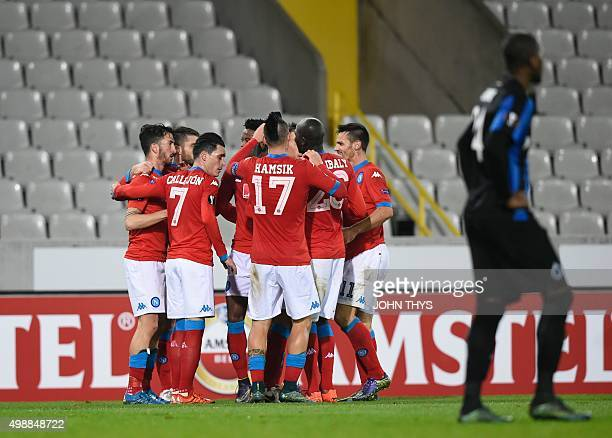 Napoli's teammates celebrate after scoring during the UEFA Europa League Group D football match between Club Brugge and SSC Napoli played behind...