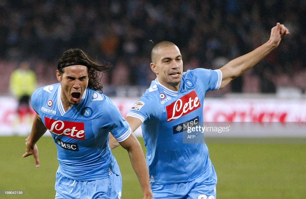Napoli's Uruguayan Forward Edinson Cavani (L) celebrates with teammate Swiss midfielder Gokhan Inler after scoring during the Serie A football match SSC Napoli vs AS Roma in San Paolo Stadium on January 6, 2013 in Naples. HERMANN