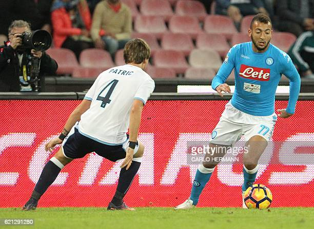 Napoli'smidfielder from Morocco Omar El Kaddouri fights for the ball with Lazio's defender from Spain Patricio Gabarron Gil during the Italian Serie...