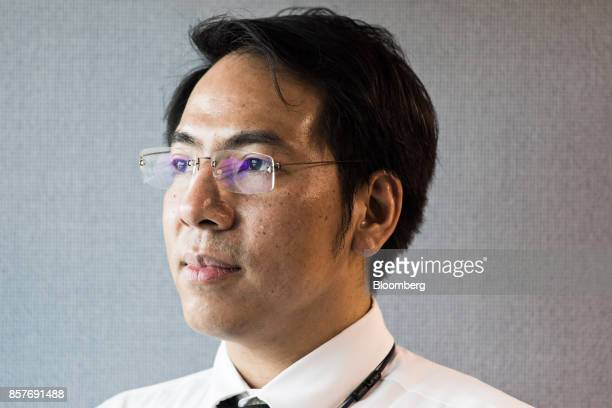 Napongthawat Phothikit director of payment systems policy at the Bank of Thailand stands for a portrait in Bangkok Thailand on Thursday Sept 28 2017...
