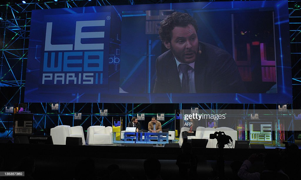 Napster co-founder, Sean Parker, General Partner of Founders Fund (L, on screen) listens to Menlo Ventures Managing Director Shervin Pishevar (C), during a session at LeWeb 11 event in Saint-Denis, suburbs of Paris, on December 9, 2011. Top industry entrepreneurs, executives, investors, senior press and bloggers gathered during three days to explore the key issues and opportunities in the web marketplace.