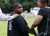 Na'Quincy son of Alton Sterling looks back at his father's grave as he leaves Alton's burial at the Mount Pilgrim Benevolent Society Cemetery July 15...