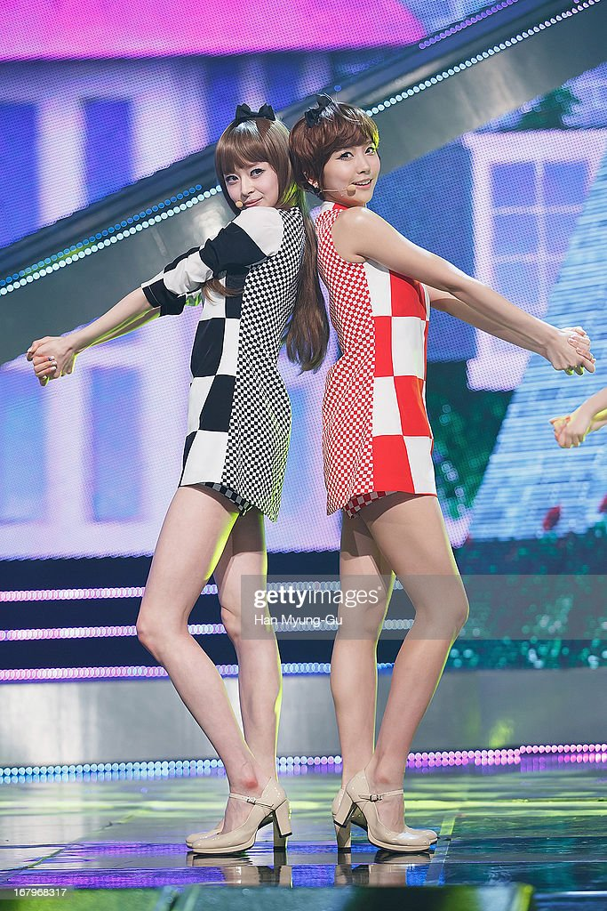 Nara and Yooyoung of South Korean girl group Hello Venus perform onstage during the Mnet 'M CountDown' at CJ E&M Center on May 02, 2013 in Seoul, South Korea.