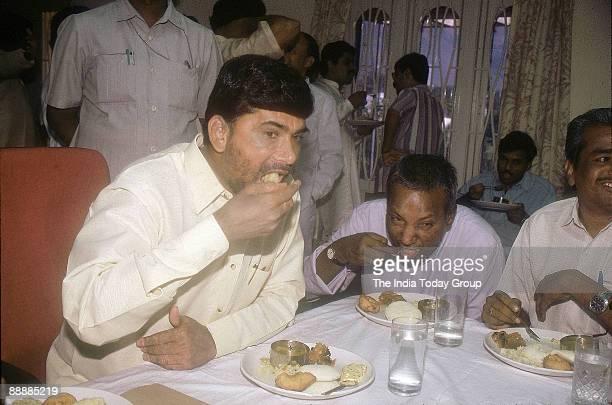 Nara Chandrababu Naidu Chief Minister of Andhra Pradesh eating breakfast with others at a party function