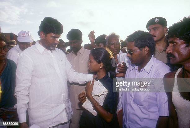 Nara Chandrababu Naidu Chief Minister of Andhra Pradesh listening to female student problems who is with the group of party Supporters