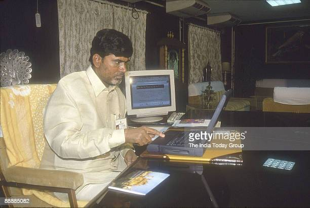 Nara Chandrababu Naidu Chief Minister of Andhra Pradesh working with his laptop in his office