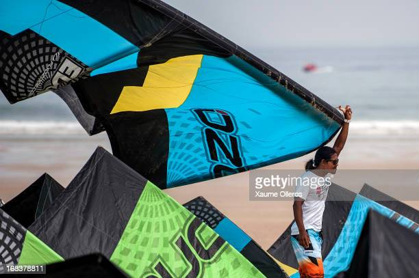 Narapichit Pudla of Thailand holds a kite during day one where of the KTA Series on Pingtan Island on May 9 2013 in Fuzhou China There was only one...