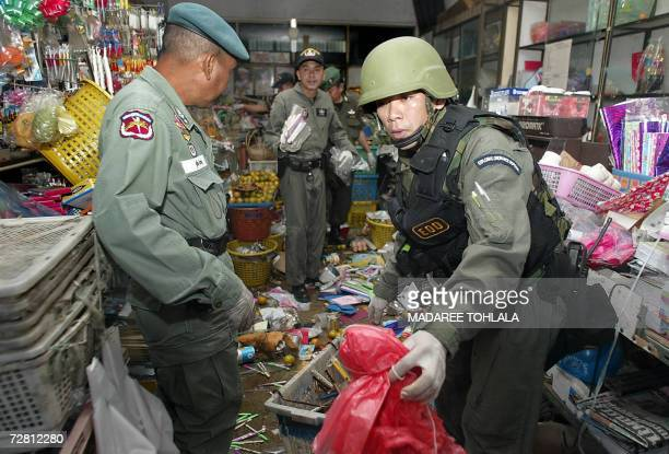 Thai soldiers inspect the damages caused by a bomb detonated by Isalamic militants at the local shop in Narathiwat province southern of Thailand 13...