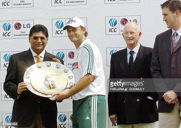 Australian cricket player Adam Gillchrist holds the LG International Cricket Council ranking trophy for the best ODI team of the year as Bangladesh...