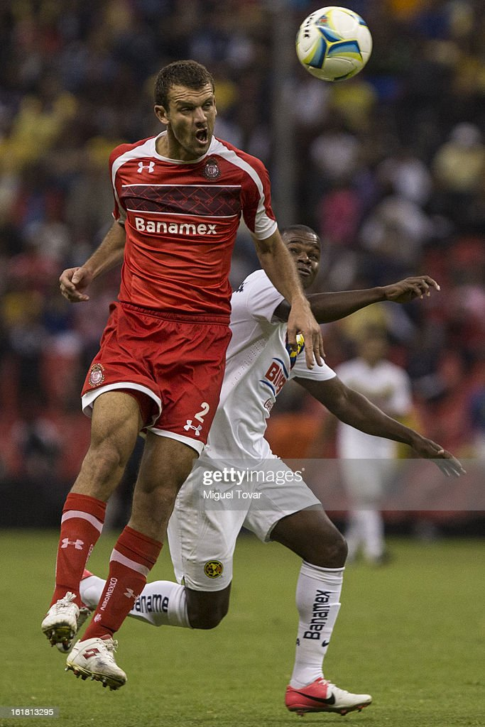 Narciso Mina of America fights for the ball with Diego Novaretti of Toluca during a Clausura 2013 Liga MX match between America and Toluca at Azteca Stadium on February 16, 2013 in Mexico City, Mexico.