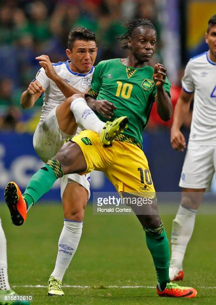 Narciso Orellana of El Salvador tries to kick from behind against Darren Mattocks of Jamaica during the 2017 CONCACAF Gold Cup at Alamodome on July...