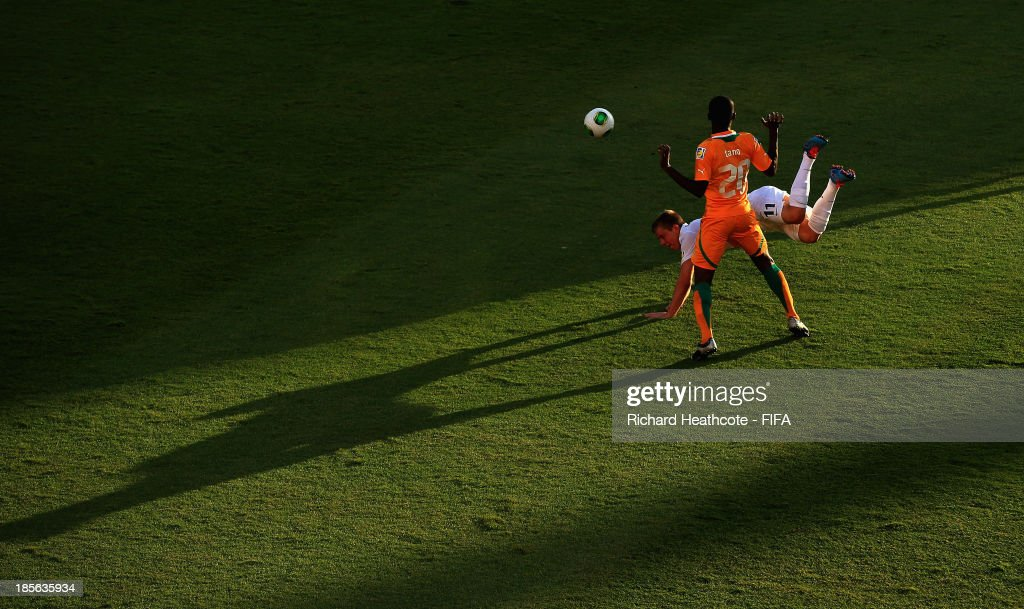 Narcisse Tano of Ivory Coast tackles Monty Patterson of New Zealand during the FIFA U-17 World Cup UAE 2013 Group B match between New Zealand and Ivory Coast at the Mohamed Bin Zayed Stadium on October 23, 2013 in Abu Dhabi, United Arab Emirates.