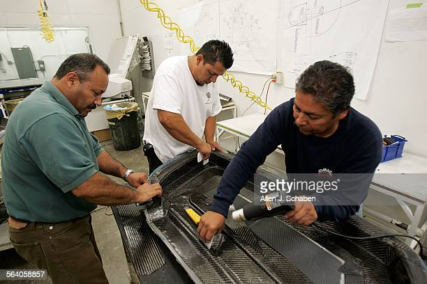 Narcisso Carrillo left Rafael Rodriguez and Ignacio Flores right spread carbon fiber material over a part at Metalcrafters in Fountain Valley where...