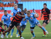Nardus van der Walt of Blue Bulls tackled by Lizo Gqoboka of Eastern Province Kings during the Vodacom Cup Quarter Final match between Vodacom Blue...