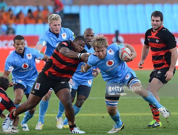 Nardus van der Walt of Blue Bulls tackled by Lizo Gqoboka of Eastern Province Kings during the Vodacom Cup Quarter Final match between Vodacom Blue...