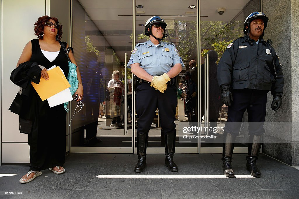 Nardyne Jefferies (L) is prevented by DC Metro Police from entering the offices of Prime Policy Group, a lobbying group that represents the National Rifle Association, during an anti-gun violence demonstration April 25, 2013 in Washington, DC. Nardyne's only child, Brishell Jones, 16, was eating pizza with a group of friends after attending the funeral of gun violence victim when men driving by in a passing car opened fire with an AK-47, killing Jones and two others in 2010.