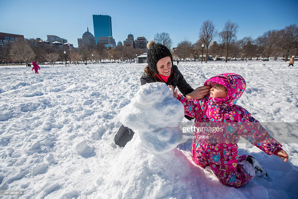 Nareisa Niedl, of Boston, left, helped her daughter, Olivia, 3, build a snowman on Boston Common after a blizzard dropped over two feet of snow in the area, Sunday, Feb. 10, 2013.