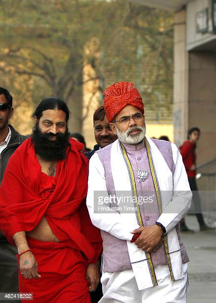 Narendra Modi and Baba Ramdev lookalikes during BJP's campaign at Delhi University Metro Station on January 28 in New Delhi India Modi's lookalike...