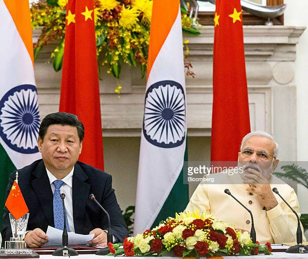 Narendra Modi India's prime minister right and Xi Jinping China's president attend a meeting to sign a series of agreements between the two nations...