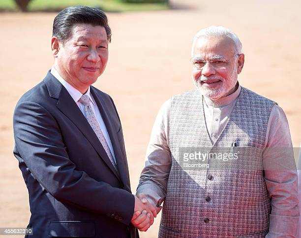 Narendra Modi India's prime minister right shakes hands with Xi Jinping China's president during a ceremonial reception at the presidential palace in...