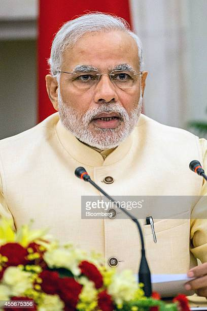 Narendra Modi India's prime minister speaks during a meeting with Xi Jinping China's president unseen to sign a series of agreements between the two...