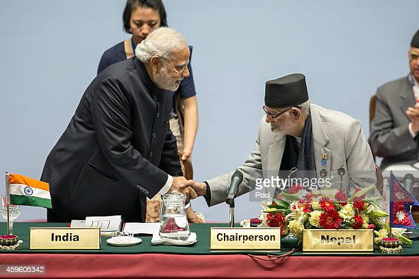 Narendra Modi Prime Minister of India greets Sushil Koirala Prime Minister of Nepal during the inaugural session of the 18th SAARC Summit on November...