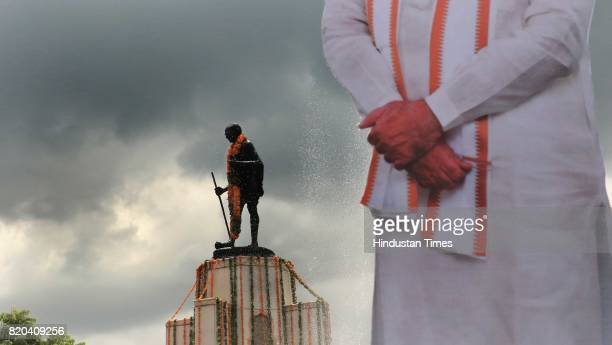 Narendra Modi's cutout at Gandhi circle where BJP National President Amit Shah pays tributes to Father of the Nation Mahatma Gandhi's statue while on...