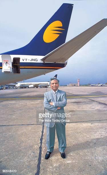 Naresh Goyal Founder Chairman of Jet Airways poses with Jet Airways Airbus at Sahar International Airport in Mumbai Maharashtra India