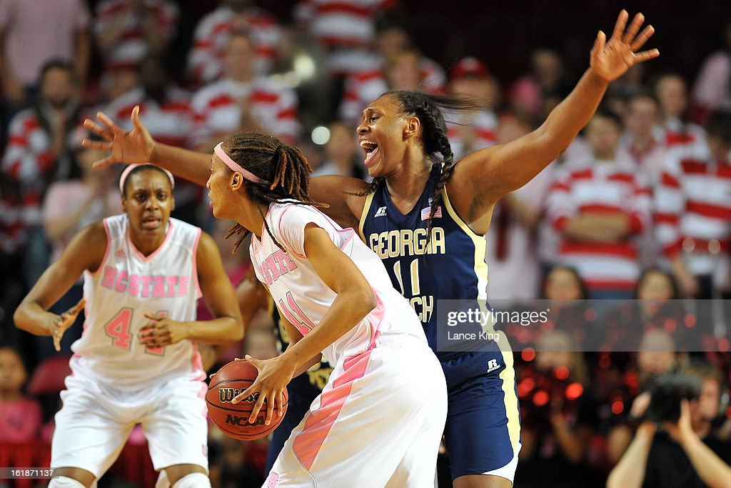 Nariah Taylor #11 of the Georgia Tech Yellow Jackets defends Lakeesa Daniel #41 of the North Carolina State Wolfpack at Reynolds Coliseum on February 17, 2013 in Raleigh, North Carolina.