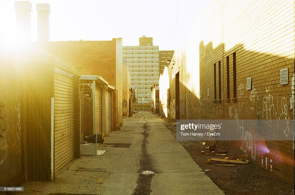Narrow Alley Along Built Structures
