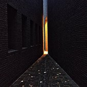 Narrow Alley Amidst Brick Wall