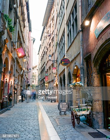 Narrow cobbled street in Lyon at dusk