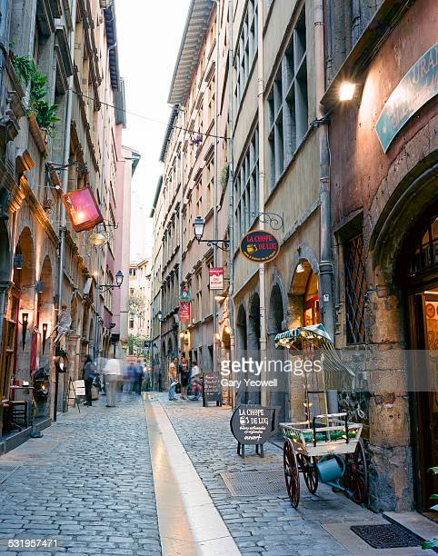 Narrow cobbled street in Lyon at dusk