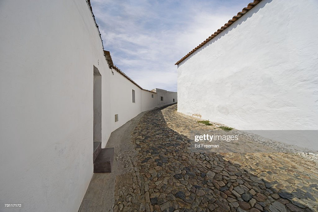narrow cobbled street portel baixo alentejox portugal