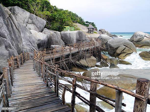 Narrow Footbridge Along Rocks