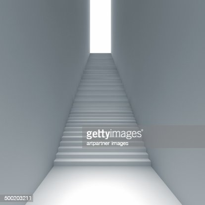 Narrow staircase leads up to the light