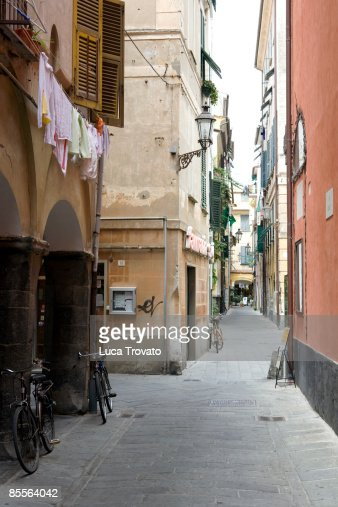 narrow street with clothing hanging to dry : Stock Photo