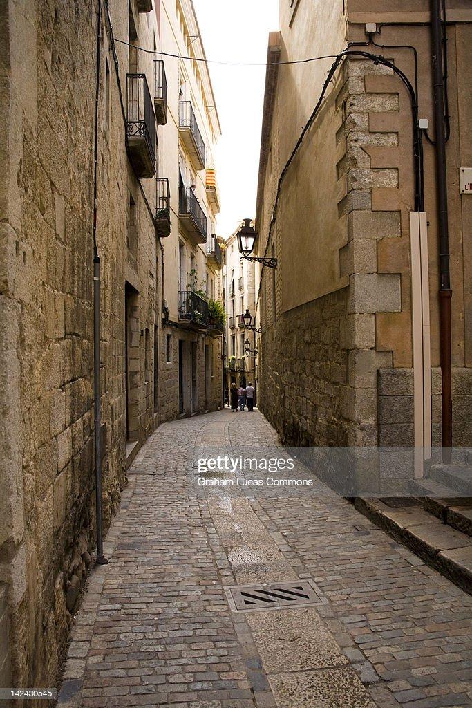 Narrow streets of Girona's old city area : Stock Photo